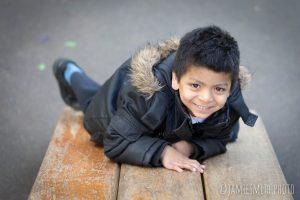 Photo of school boy on slide