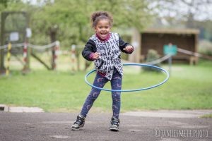 Photo of girl playing with hoop