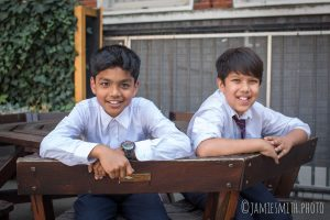 Photo of school boys on a bench